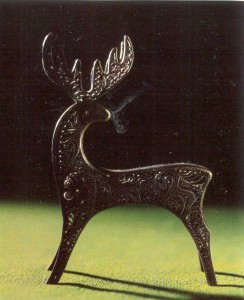 Filigree metal figurine of a young deer