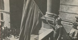 The raising of the red banner on the balcony of the Opera House