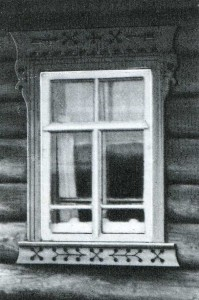 The platbands of northern log huts executed in equipment of a propilovka