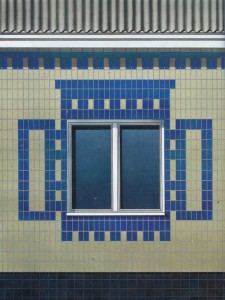 Fragment of facade panel houses, lined with ceramic tiles.
