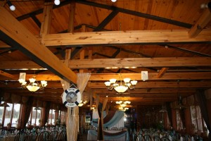 Wooden beams look very good and can hang beautiful lighting and décor.