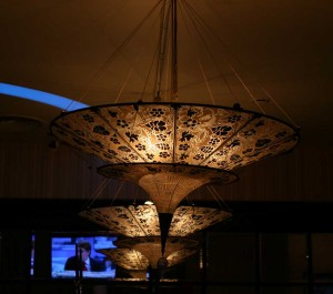 Two cone-shaped lamps in the Chinese style make the setting in a cafe a more private and intimate.