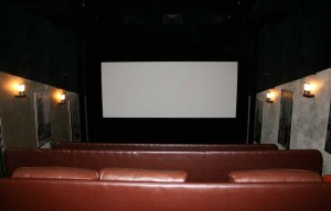 A small cinema with expensive leather chairs.