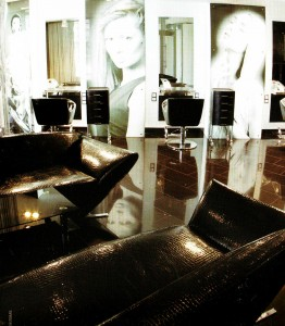 The combination of black and white. Large pictures on the walls. Special furniture for beauty salon.
