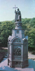 "The monument to Prince Vladimir Svyatoslavich. 1853 Sculptors Vasily Demuth-Malinovsky and P. Klodt, architect KA Ton. Mounted on the lower terrace of Vladimir's Hill, at an altitude of 70 meters above the Dnieper, the monument combines well with the silhouette of the Dnieper hills. Bronze sculpture of the prince in the mantle with the cross and the grand cap in hand stands on a 16-meter cast iron pedestal and crowned with an octagonal pedestal in the form of the pseudo-style chapel. Brick-lined cast iron pedestal plates and decorated with bronze bas-relief of the east side of ""Baptism of Rus' and the old coat of arms of Kiev."