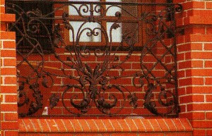 Brickwork and wrought grill with vegetable
