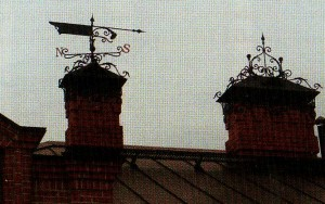 Forged wrought-iron weather vane and visors for pipes look very impressive setting a romantic mood.
