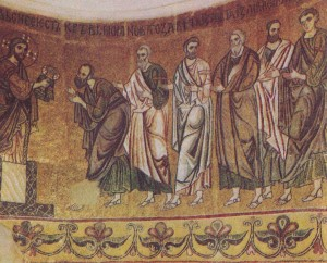 """The Eucharist."" Fragment of mosaic of St. Michael's Cathedral. XII century. St. Michael's Cathedral was the last of an ancient building in Kiev, where applied mosaic murals. In 1934-1935 in connection with the reconstruction of the cathedral was demolished, all the surviving paintings removed from the walls and moved to a new cement base. To organize them into Sophia was allocated one of the buildings of the XVIII century. In the hall a wooden apse corresponding apse of the Cathedral of St. Michael, and its concave surface at the same height, put the scene, ""the Eucharist."""