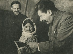 Comrade Stalin and Andreev and pioneer Mamliyaht Nahangova (the picture was taken at the meeting of the advanced farmers and female collective farmers of Tajikistan and Turkmenistan, December 1935)