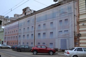 Durable fabric with a silhouette of the building is used to close a house in disrepair.