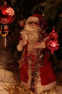 Santa Claus underneath the Christmas tree.