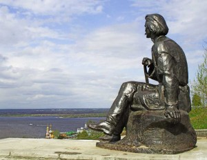 The writer Maxim Gorky is looking at the river Volga.