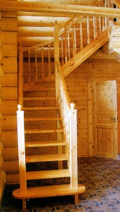 A wooden staircase in a wooden house.