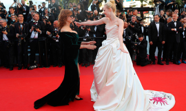 Actresses Susan Sarandon and Elle Fanning greet each other upon arrival at the opening ceremony and the screening of the film Ismael's Ghosts at the 70th international film festival