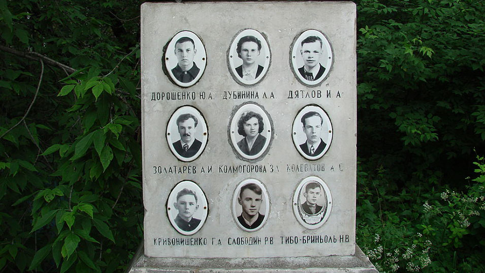 Photos of members of the tour group at their monument.