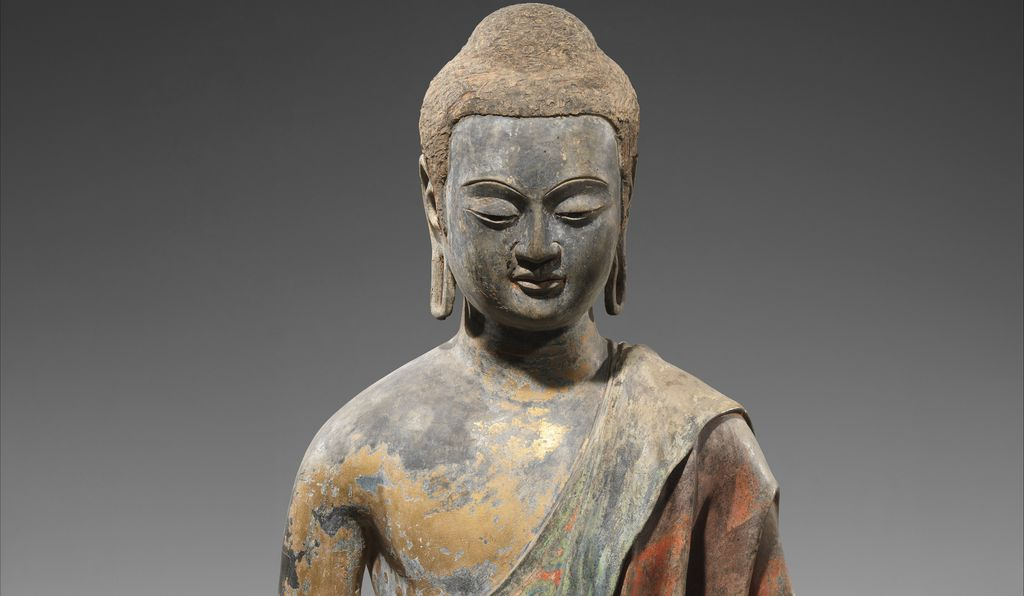 The Met Buddha (detail) is the best-preserved of the three, and is another early example of the hollow-core technique. Still visible on its exterior are traces of gold leaf and once-dazzling green and red paint.